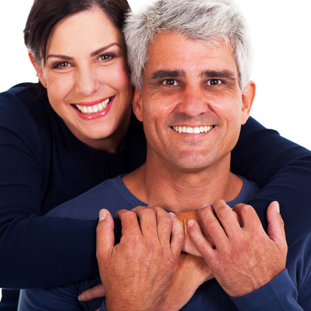 older-couple-hugging-and-smiling