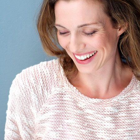 pretty-older-woman-smiling-and-laughing-shyly
